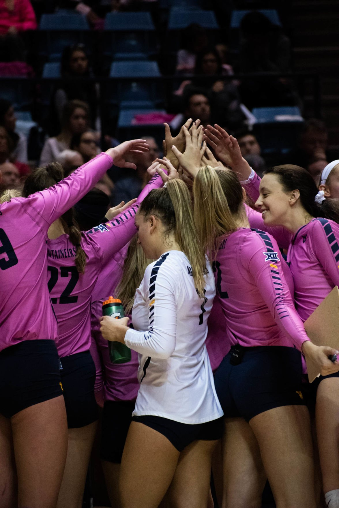 WVU breaks the huddle between sets against Texas Tech on Nov. 16, 2019 at the WVU Coliseum.