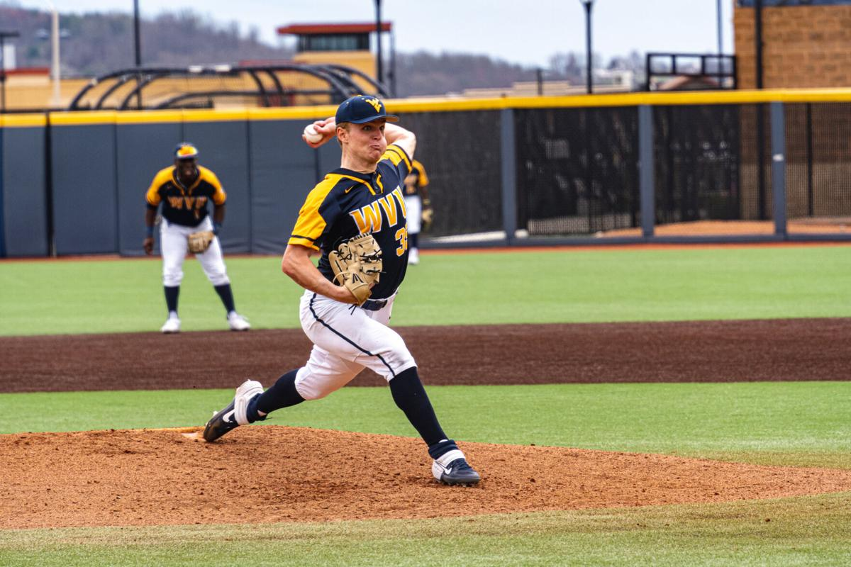 WVU junior pitcher Adam Tulloch delivers a pitch against the Kansas Jayhawks on March 27, 2021, in Morgantown, W.Va.