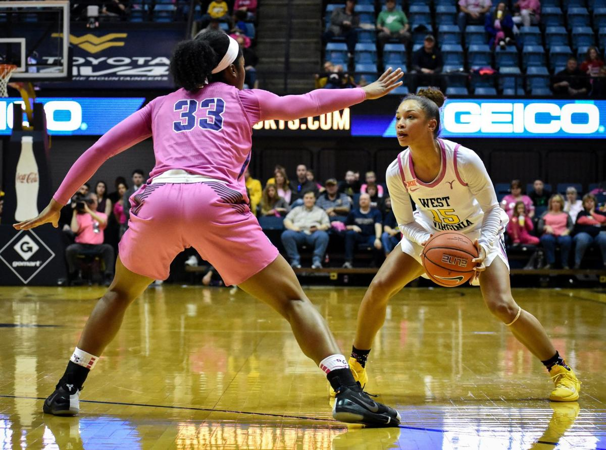 West Virginia's Lucky Rudd looks downcourt while being guarded by TCU's Adeola Akomolafe