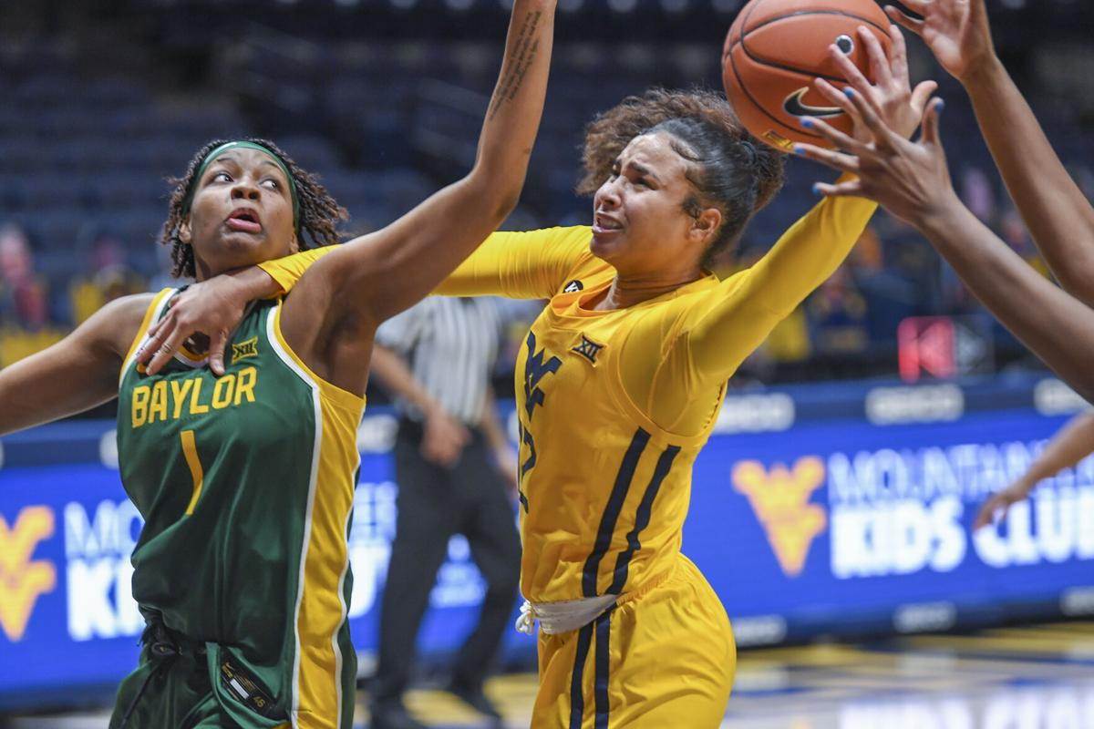 West Virginia's Esmery Martinez goes up for a basket against the Baylor Bears at the WVU Coliseum in Morgantown, W.Va., on Dec. 10, 2020.