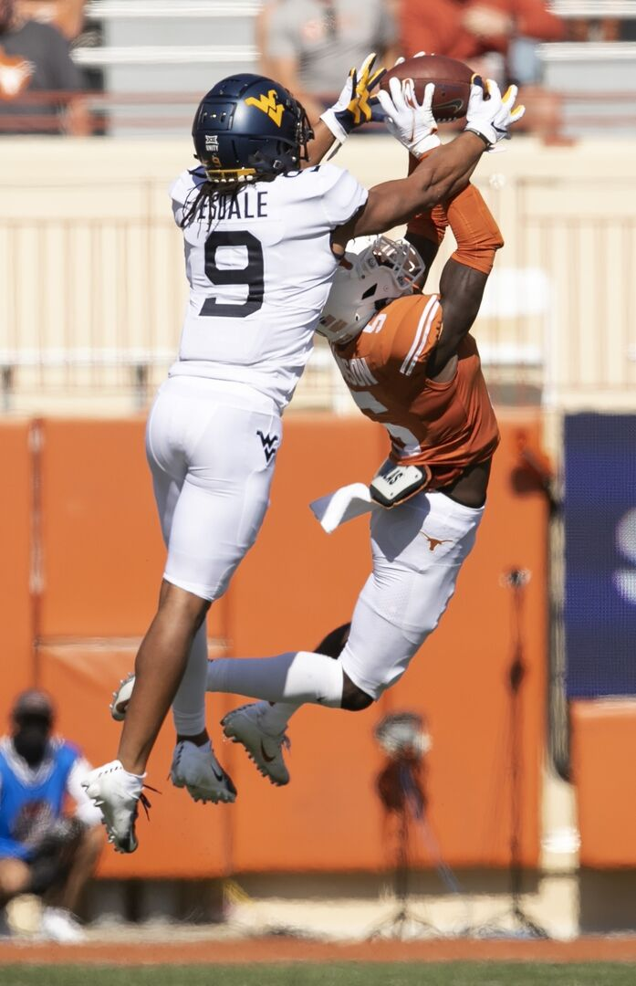 Isaiah Esdale (9) steals a pass from a Texas defender in a 17-13 loss to the Texas Longhorns in Austin, Texas on Nov. 7, 2020.