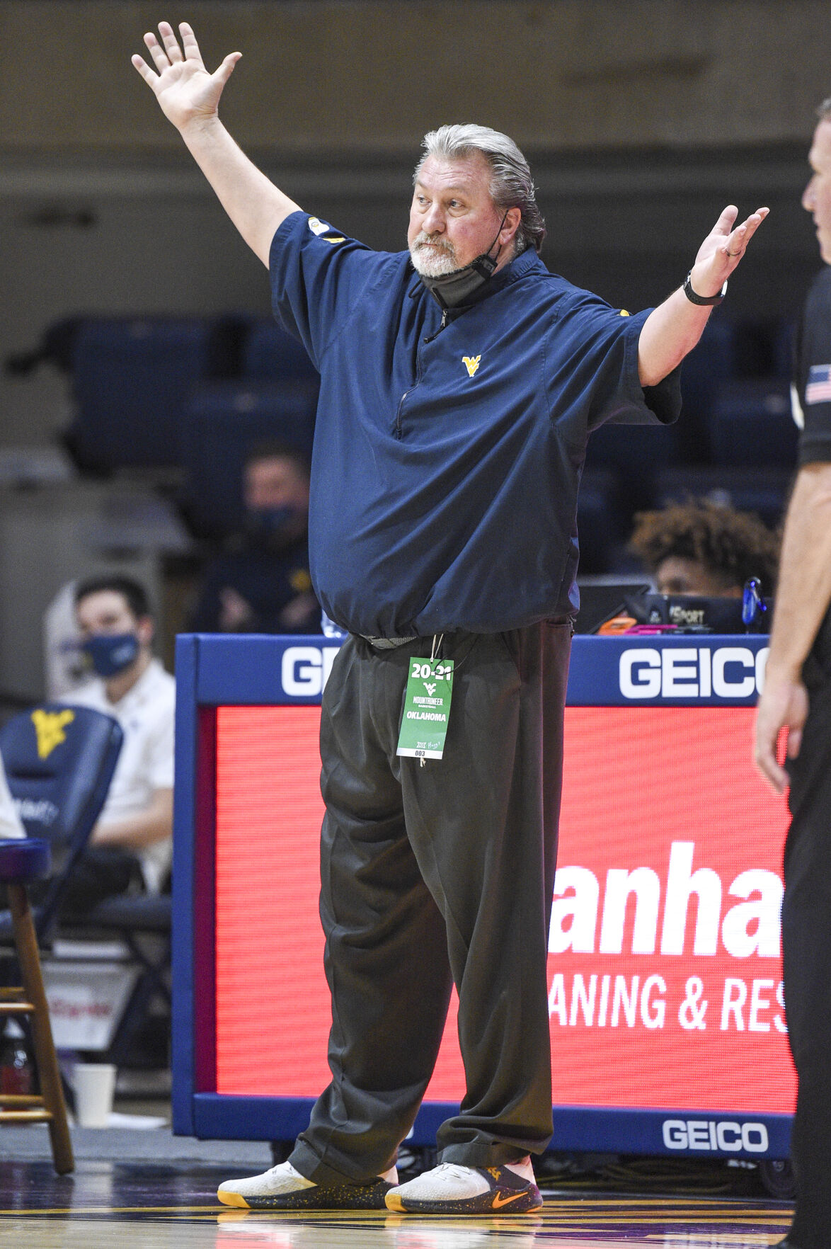 West Virginia head coach Bob Huggins disagrees with a call during West Virginia's game against Oklahoma at the WVU Coliseum on Feb. 13, 2021.