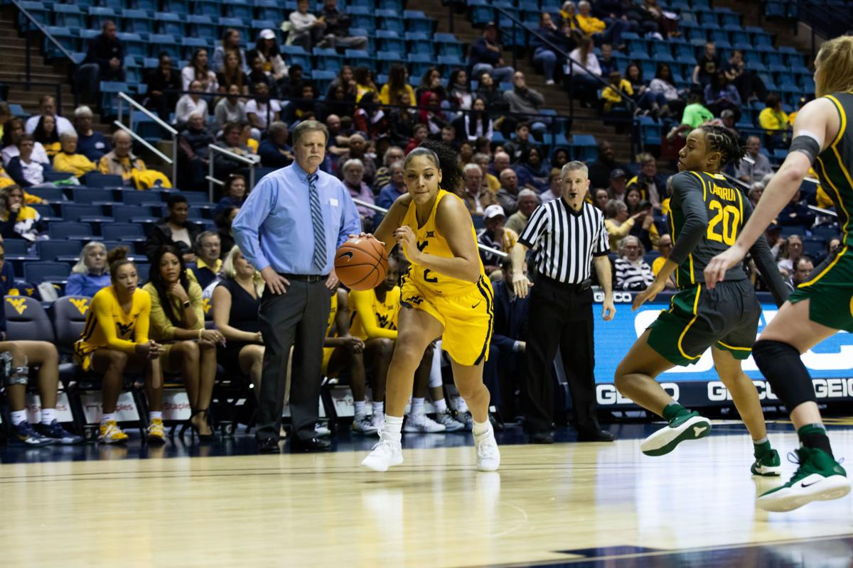 Feb. 24, 2020. WVU Coliseum. WVU guard Kysre Gondrezick dribbles into the paint during a game vs Baylor.