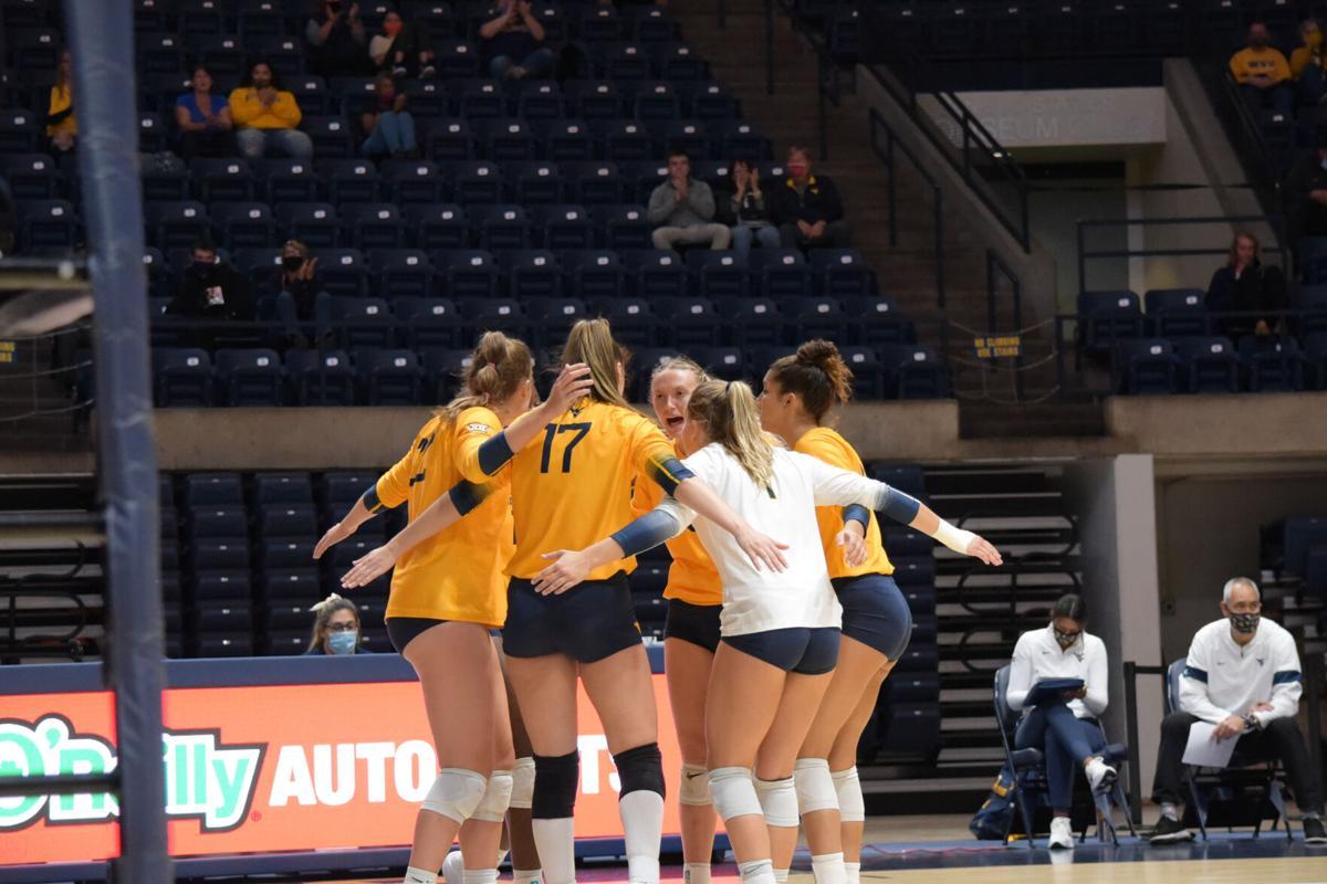 WVU volleyball team celebrates against Kansas State on Oct. 2, 2020.