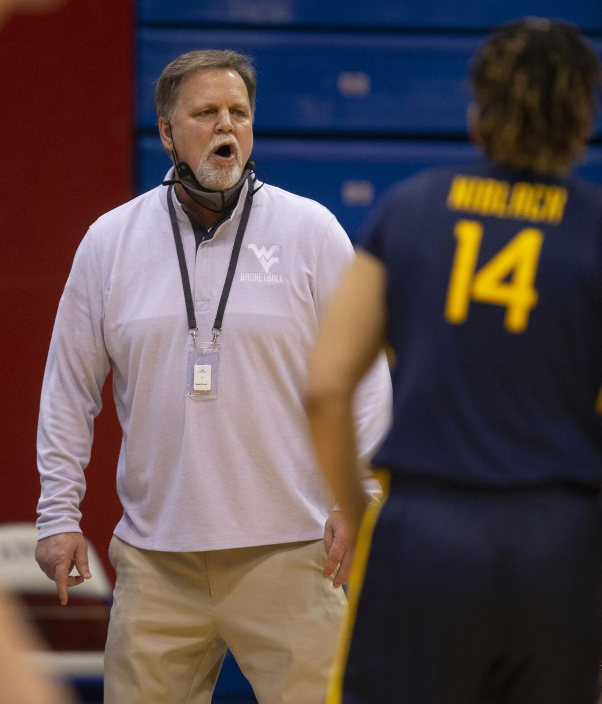 West Virginia head coach Mike Carey coaches his team against the Kansas Jayhawks in Lawrence, Kansas, on Feb. 27, 2021.
