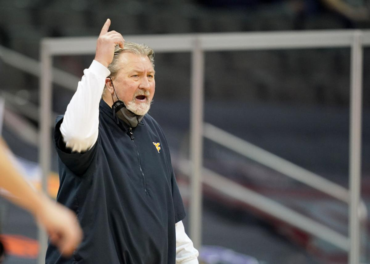 West Virginia head coach Bob Huggins shouts instructions to his team against the Oklahoma State Cowboys in the quarterfinal round of the Big 12 Conference Tournament in Kansas City, Missouri, on March 11, 2021.