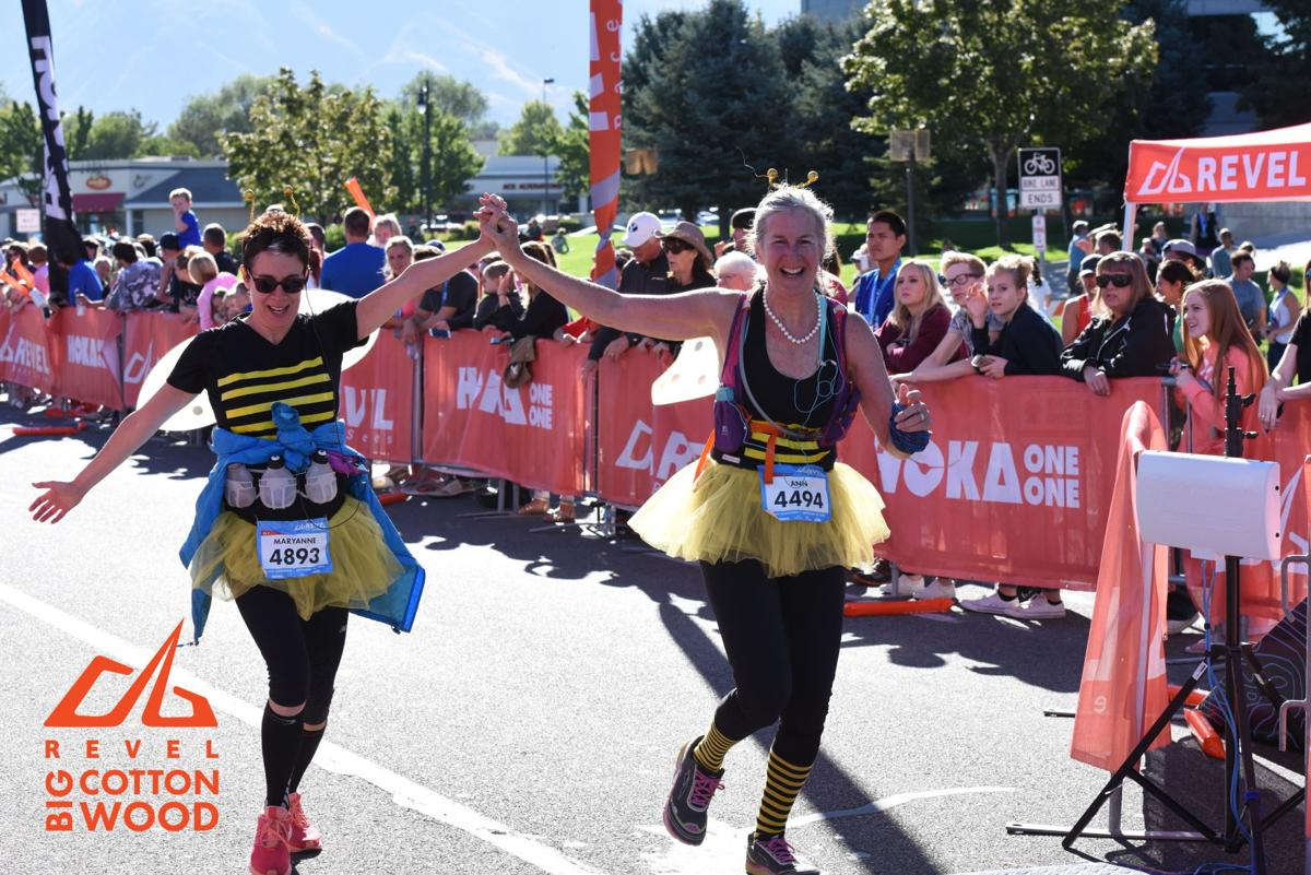 Donning bumblebee costumes, Reed (left) and Chester run in the Big Cottonwood Canyon half-marathon in Utah.