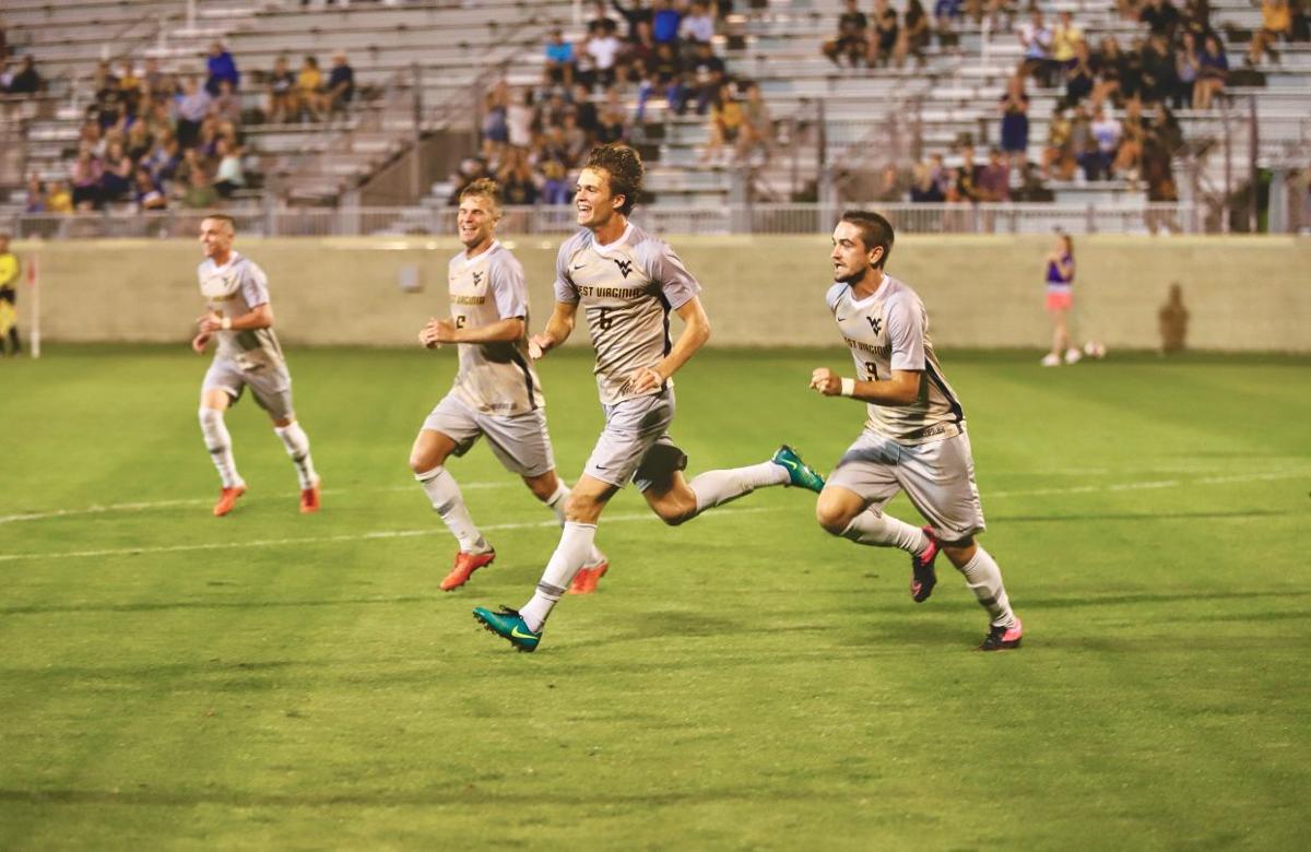 WVU men's soccer celebrates during a game