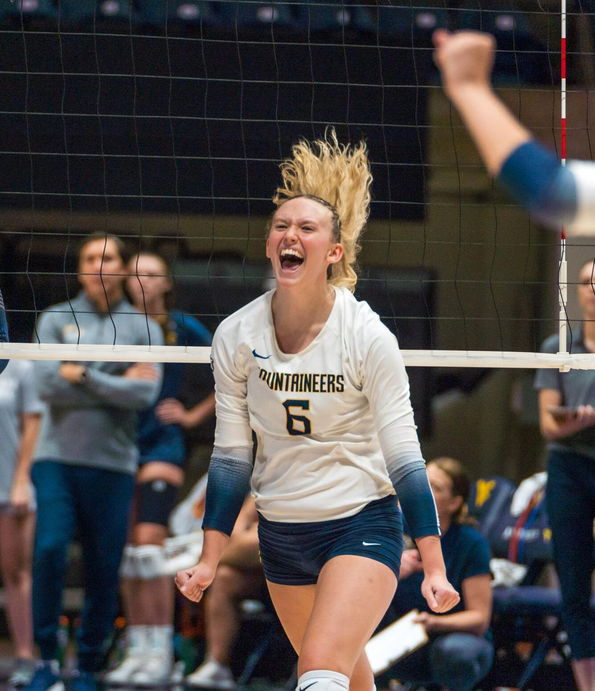 Lacey Zerwas (6) celebrates during WVU Women's volleyball exhibition match against Kent State on Aug. 20, 2021.