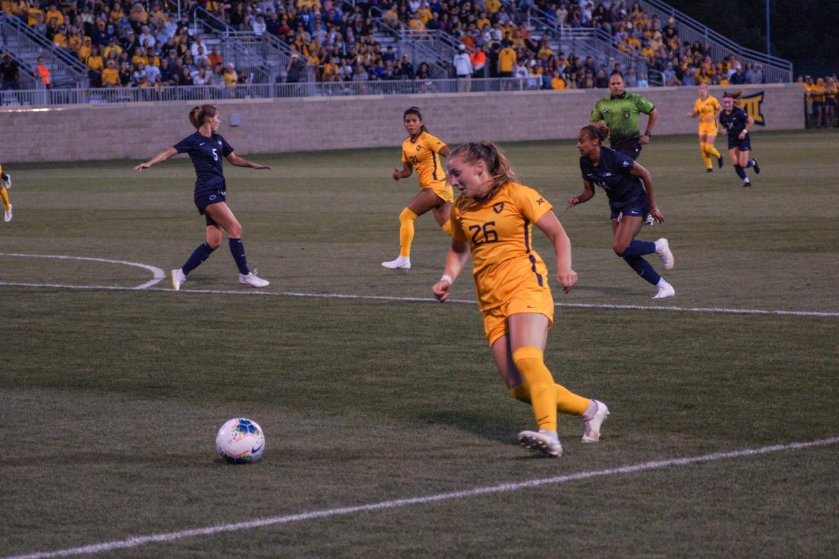 West Virginia defender Julianne Vallerand lines up a shot against Penn State.