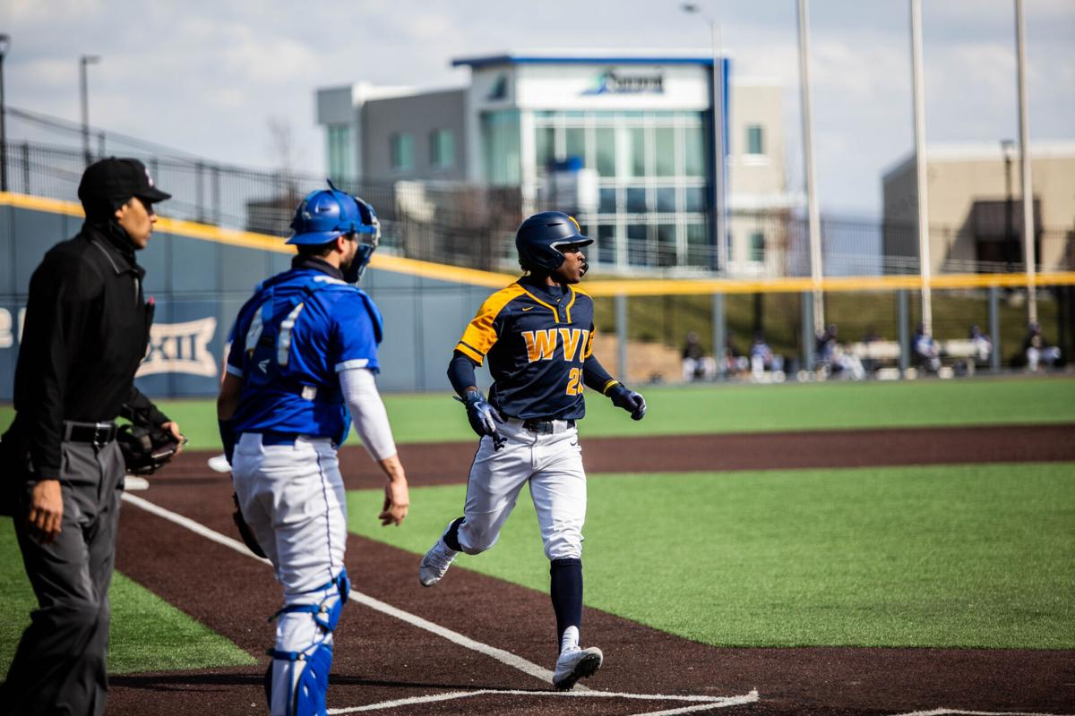 Junior outfielder Austin Davis touches home plate during West Virginia's victory over Morehead State on Tuesday at Monongalia County Ballpark in Morgantown, W.Va.