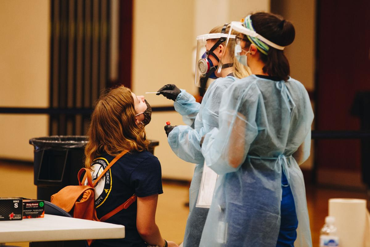 A WVU student is administered a COVID-19 test by University personnel in the Mountainlair ballrooms on August 21, 2020.