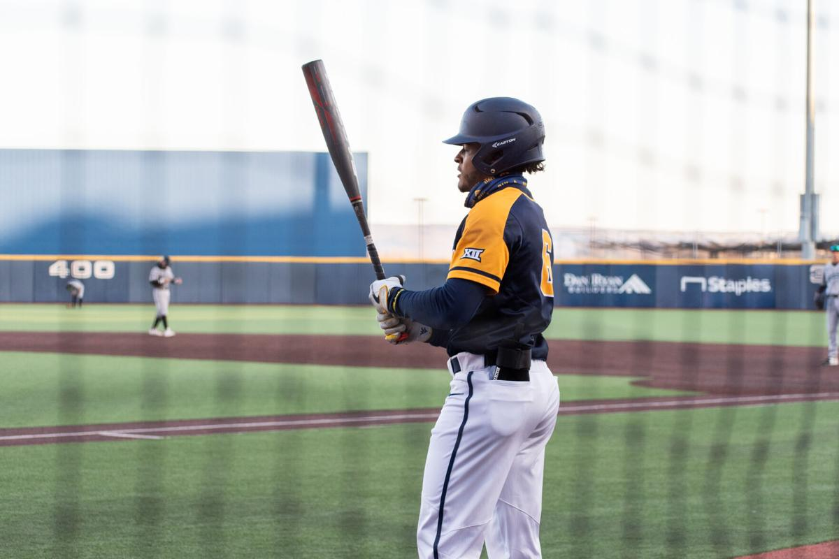 Sophomore Victor Scott prepares to bat against the Coastal Carolina Chanticleers on March 19, 2021, at Monongalia County Ballpark.