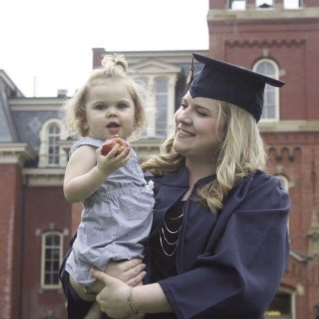 A former WVU student with her young daughter
