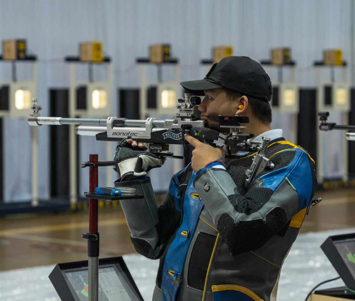 A West Virginia Mountaineer competes in the air rifle competition in West Virginia's quad-match versus Akron, Ole Miss and Navy on Jan. 30, 2021.
