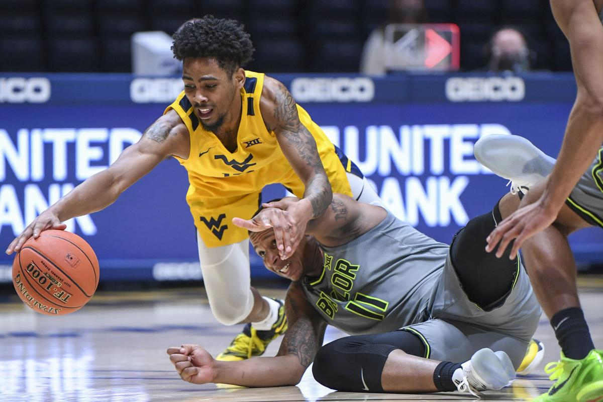 West Virginia guard Taz Sherman goes for a loose ball against Baylor's Mark Vital at the WVU Coliseum on March 2, 2021.