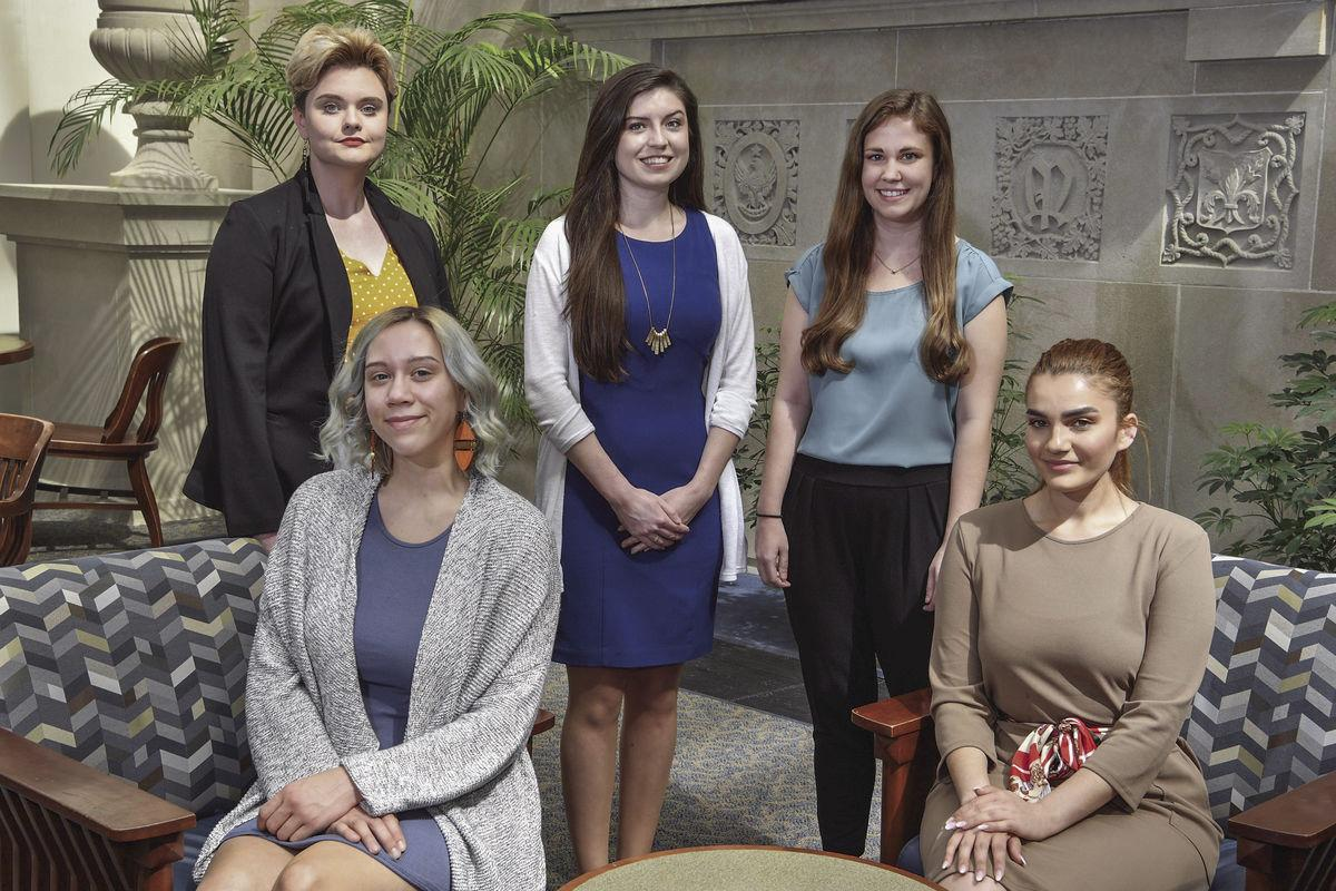 WVU's 2019 Fulbright Scholars front row from left: Constantia Rhinehart and Jana El-Khatib. Back row from left: Kaley Hensley, Karen Laska and Jordan Miller. The scholars were photographed at the Wise Library on the downtown campus.