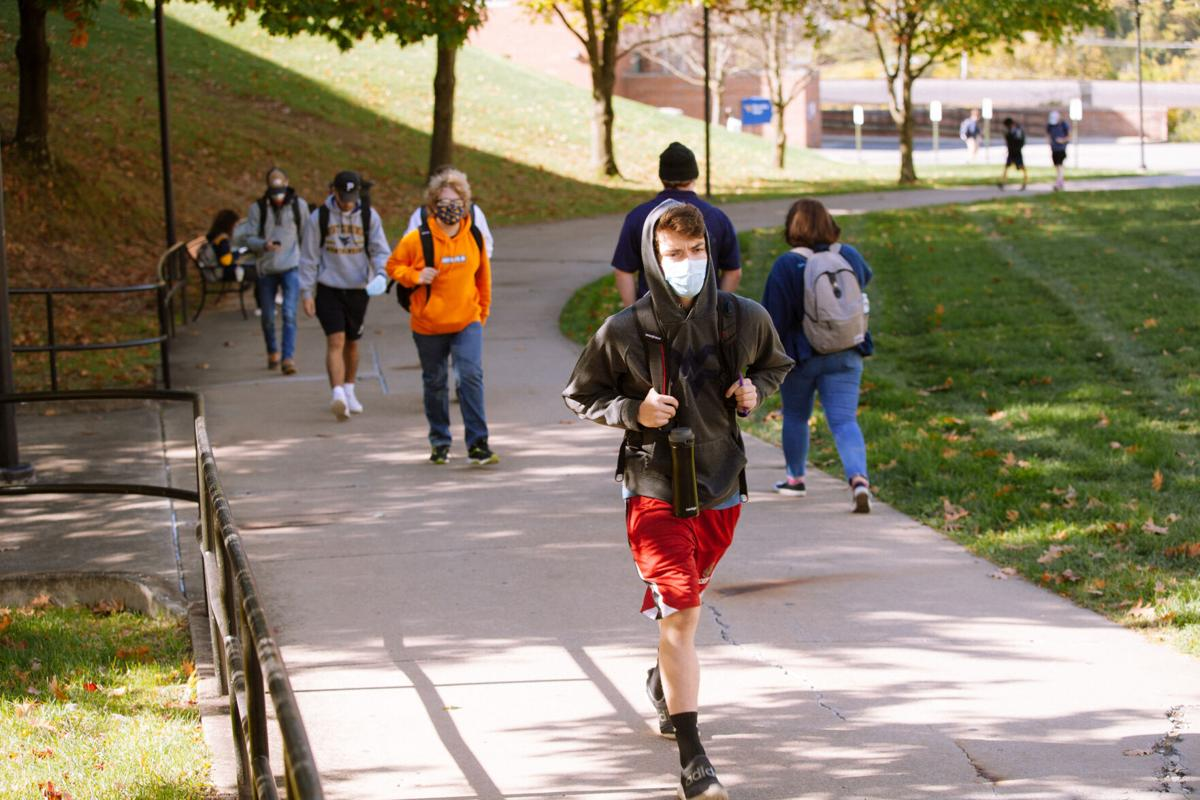 A WVU student walks to class in Woodburn Circle on Oct. 14, 2020.