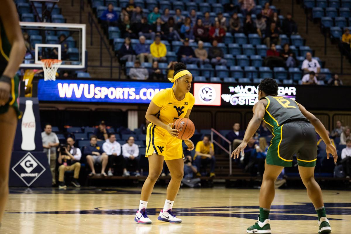 Feb. 24, 2020. WVU Coliseum. WVU forward Kirsten Deans looks down the court during a game vs Baylor.