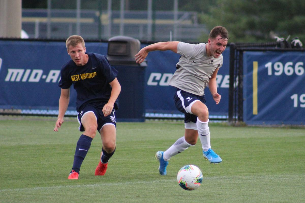 Midfielder Luke McCormick drives with the ball during a preseason scrimmage.