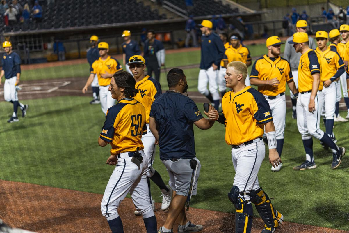 West Virginia walks off the field following a win over Kansas on March 27, 2021 at the Monongalia County Ballpark in Morgantown, W.Va.