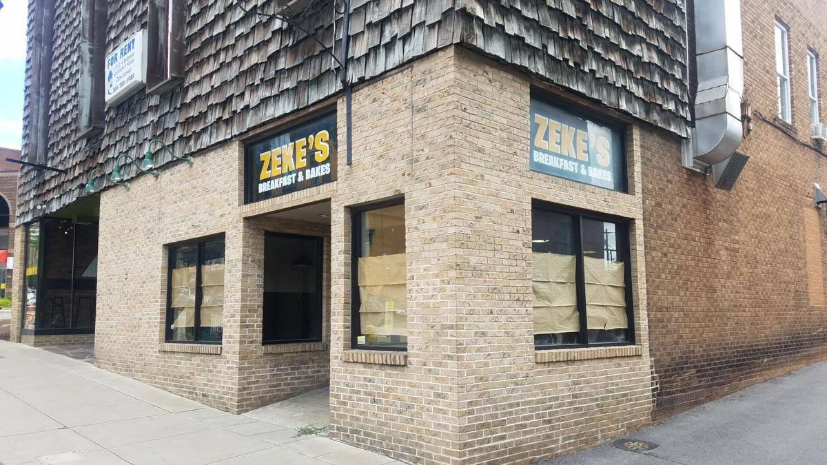 Zeke's storefront: a brick building with a sign reading