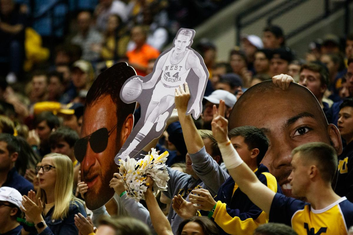 A cardboard cutout of Jerry West is held by a fan during West Virginia's season opener against Akron on Nov. 8, 2019 at the WVU Coliseum.