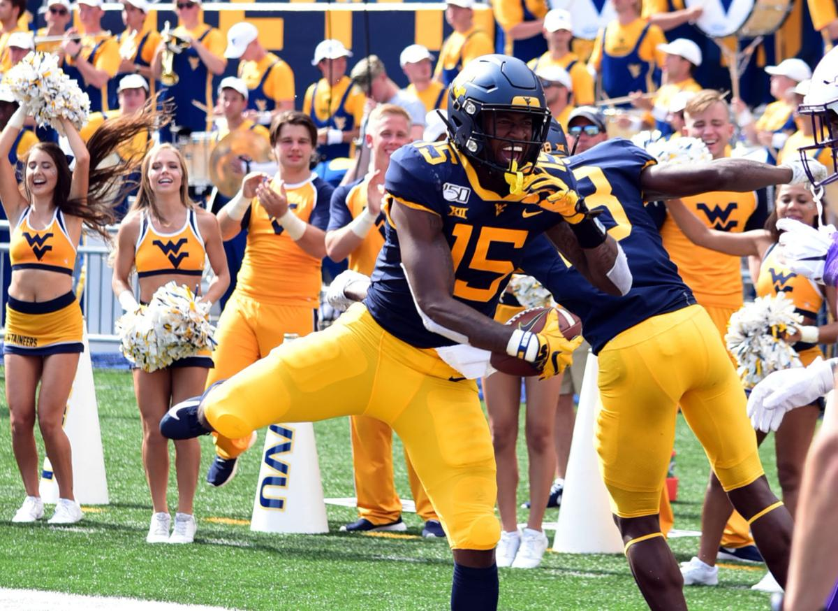 West Virginia wide receiver George Campbell celebrates his touchdown with a teammate.