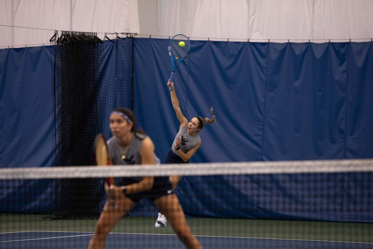 WVU junior Nicole Roc serves the ball in a doubles match against Buffalo on Feb. 7, 2020, in Morgantown, W.Va.