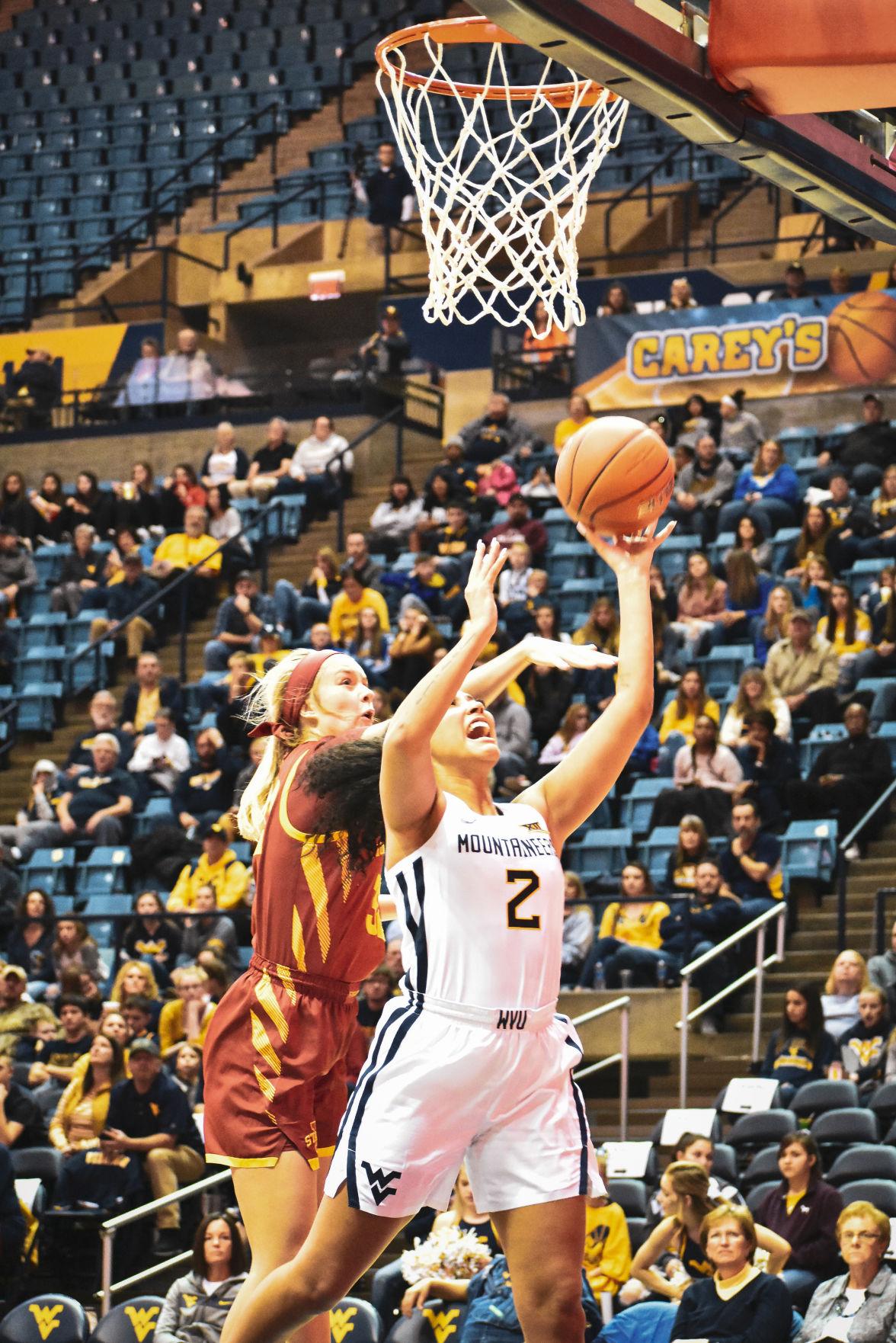 Feb. 2nd 2020 - Redshirt Junior Kyrse Gondrezick puts up a tough shot against Iowa State at the Coliseum