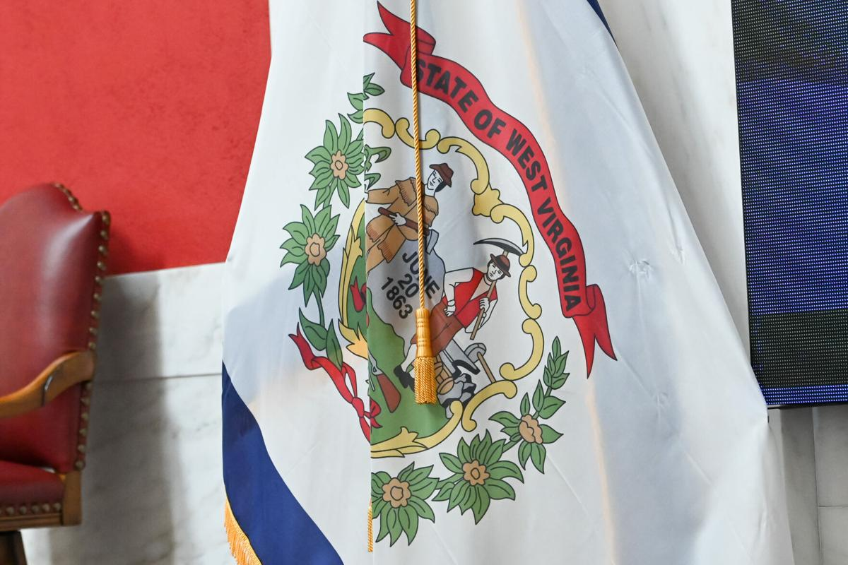 The flag of West Virginia hangs motionless in the state Senate chamber during the 2021 legislative session.
