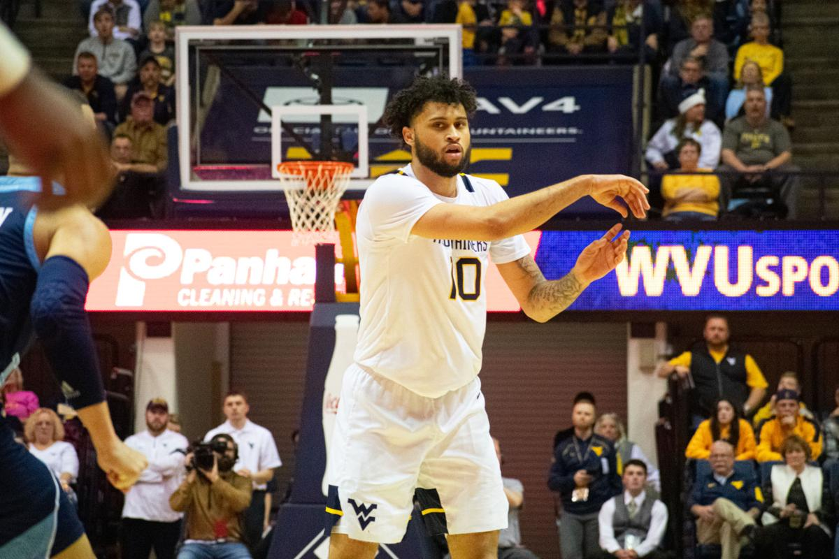 West Virginia guard Jermaine Haley passes the ball to a teammate