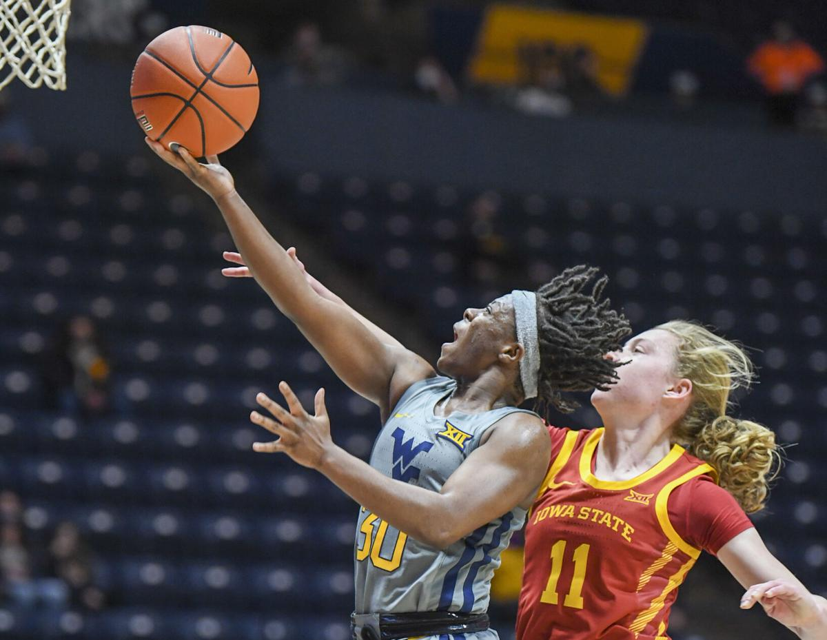 West Virginia guard Madisen Smith (30) puts up a layup against the Iowa State Cyclones on Feb. 3, 2021.