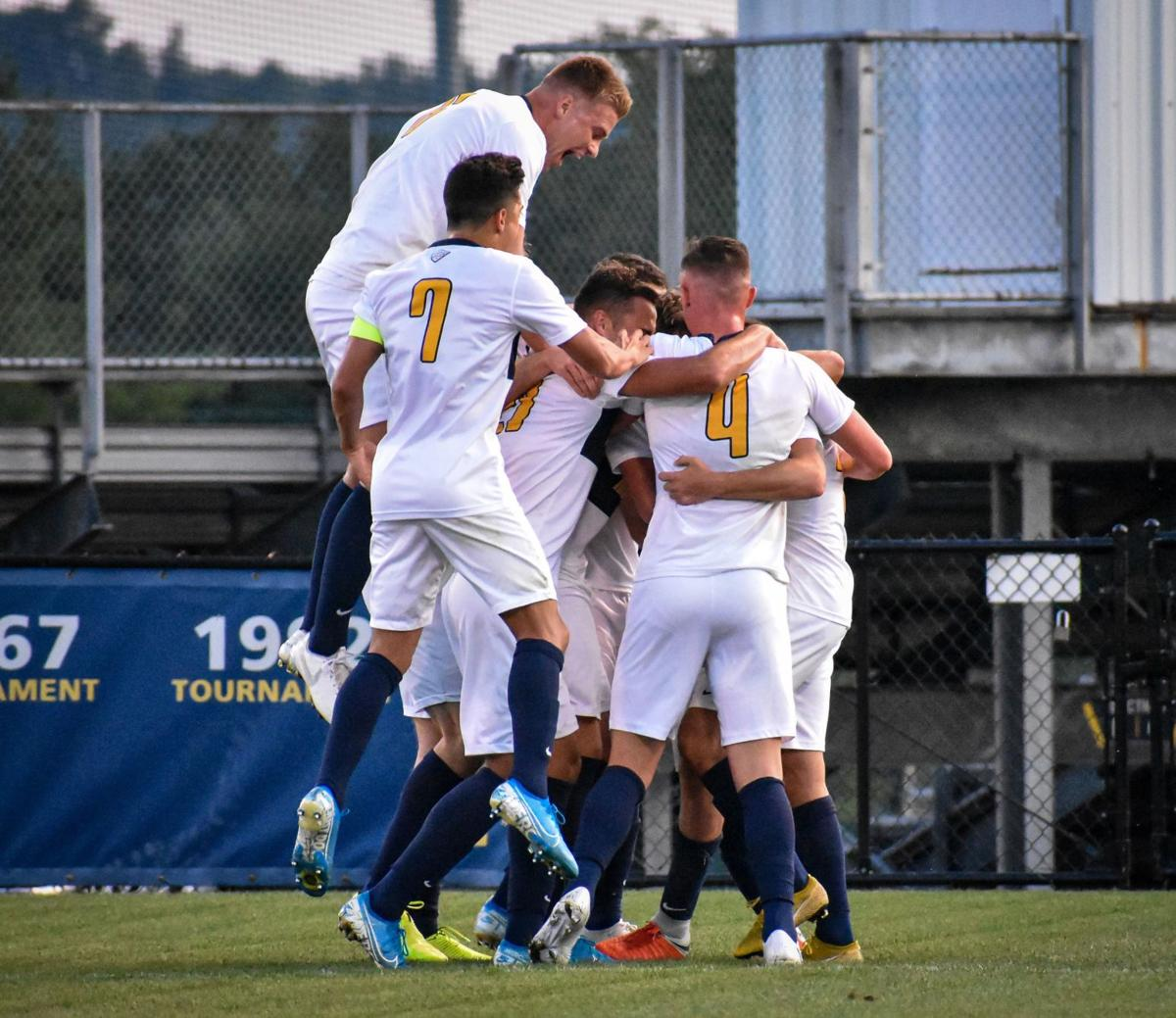 The Mountaineers celebrate after scoring the first goal of the game against Wright State.