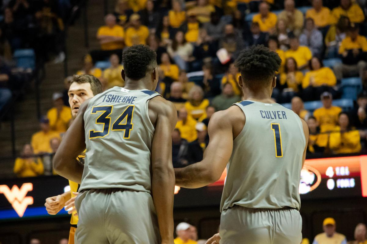 Oscar Tshiebwe and Derek Culver celebrate after a successful play against Missouri at the WVU Coliseum on January 25, 2020.