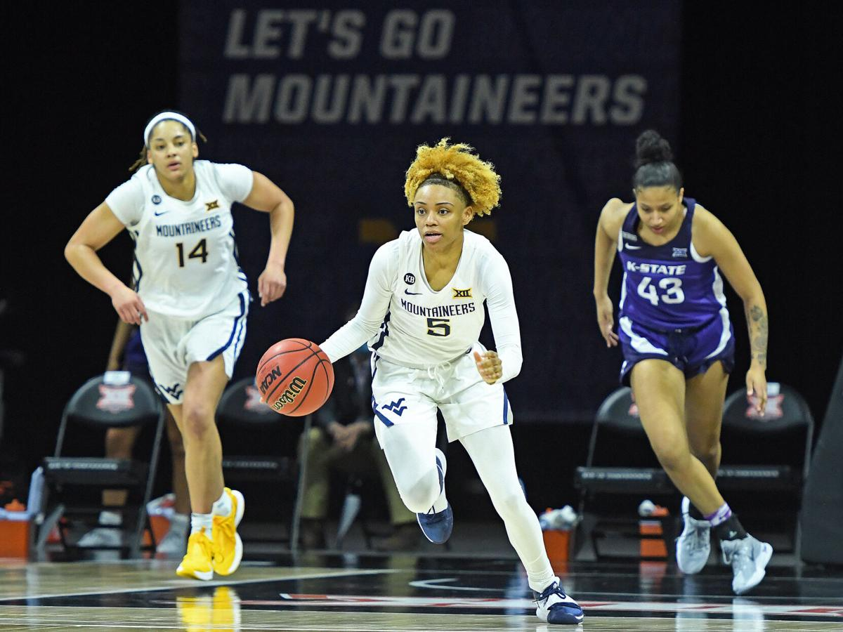 West Virginia guard Jasmine Carson brings the ball down the floor against Kansas State in the Big 12 Conference Tournament quarterfinals in Kansas City, Missouri, on March 12, 2021.