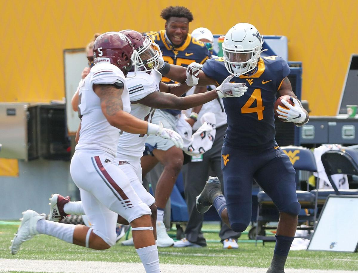 Junior running back Leddie Brown shoves off an Eastern Kentucky player