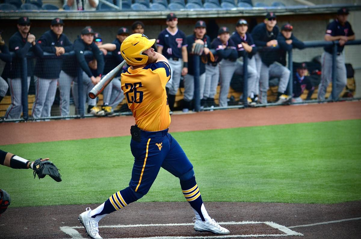West Virginia's Vince Ippoliti swings at a pitch against Texas Tech on April 18, 2021, in Morgantown.