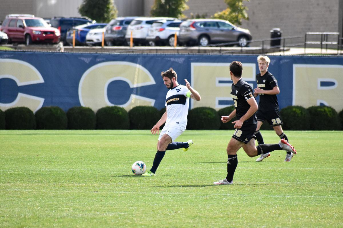West Virginia's Pascal Derwaritsch drives with the ball against Western Michigan on October 13, 2019.