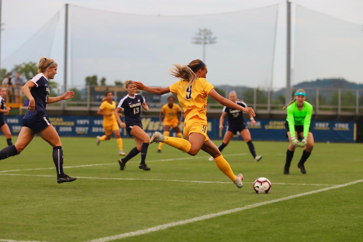 Forward Lauren Segalla attempts to cross the ball into the box during a game against Xavier.