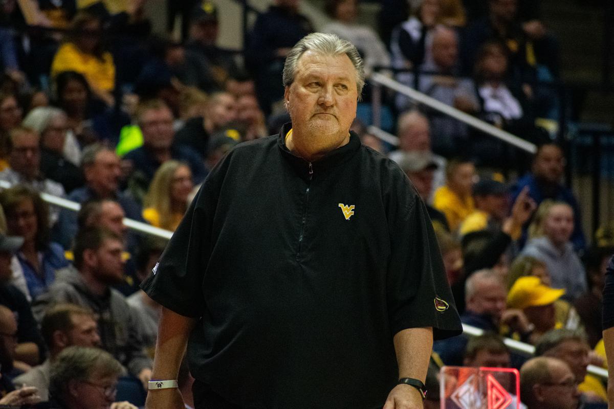 Bob Huggins coaching the Mountaineers against Rhode Island.