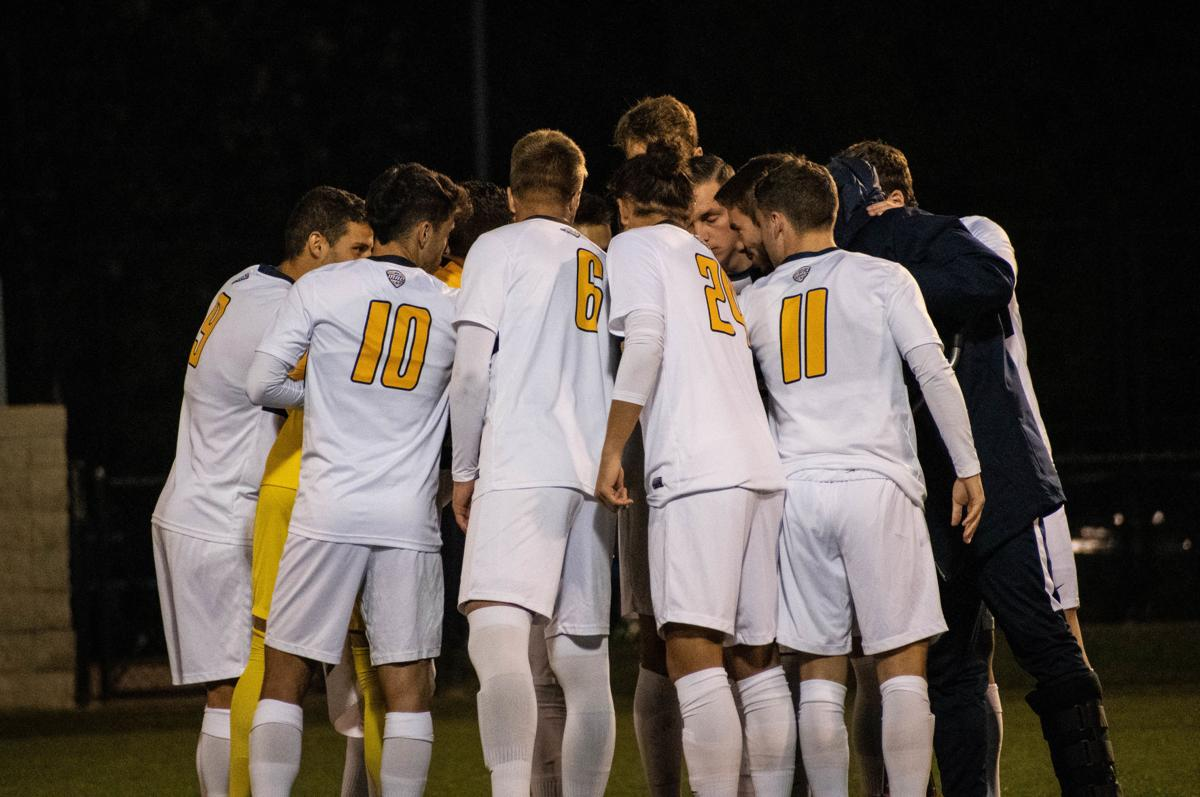 Members of the West Virginia men's soccer team huddle up prior to taking on Northern Illinois at Dick Dlesk Soccer Stadium on October 18, 2019.