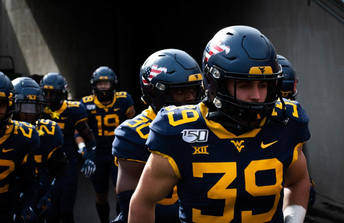 West Virginia's Dante Bonamico leads the Mountaineers out of the tunnel prior to taking on Texas Tech at Milan Puskar Stadium on Nov. 9, 2019.