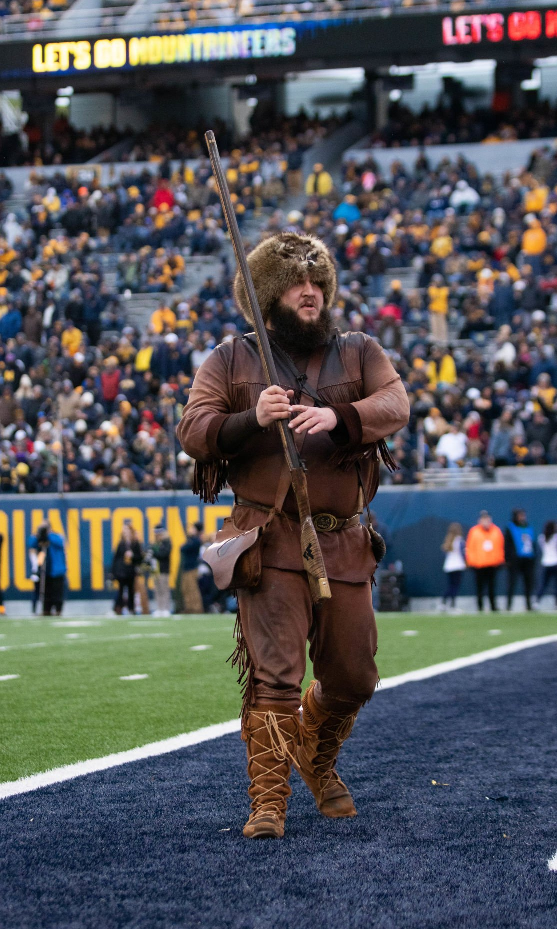 Mountaineer Mascot Timothy Eads celebrates as the Mountaineers enter the red zone against Oklahoma State at Milan Puskar Stadium on Nov. 23, 2019.