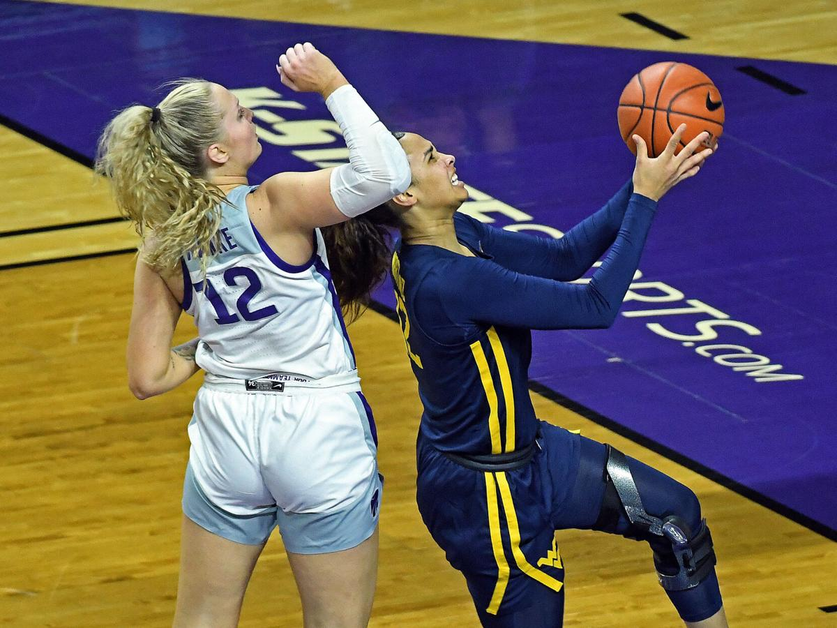 West Virginia forward Esmery Martinez shoots a layup against the Kansas State Wildcats on March 3, 2021.
