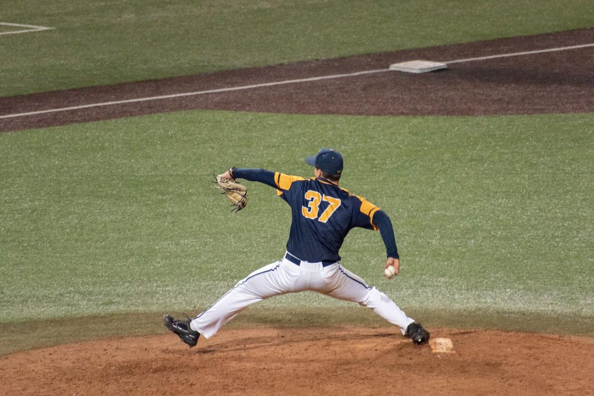Junior Zach Ottinger rearing back to pitch the ball to Coastal Carolina on March 19th, 2021 at the Monongalia County Ballpark.