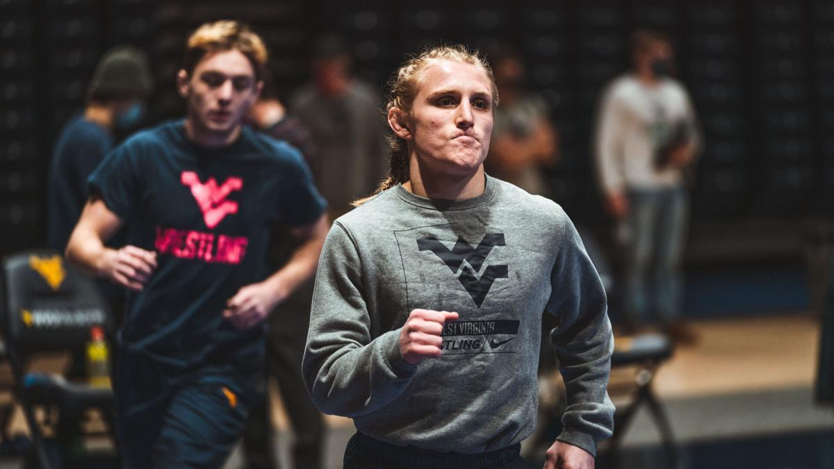 West Virginia wrestler Killian Cardinale works out during a WVU wrestling practice.
