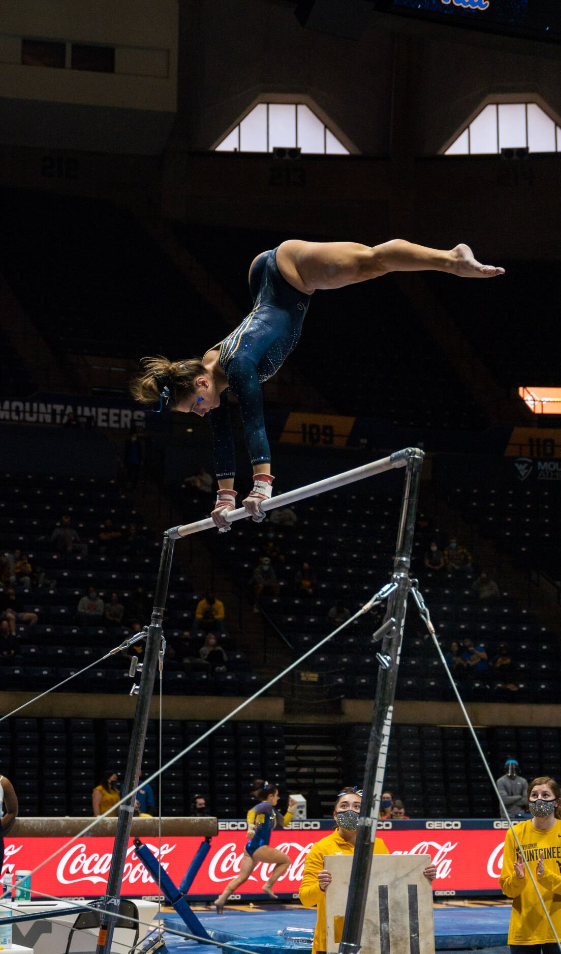 A West Virginia gymnast competes in the Big 12 Championships at the WVU Coliseum on March 20, 2021.