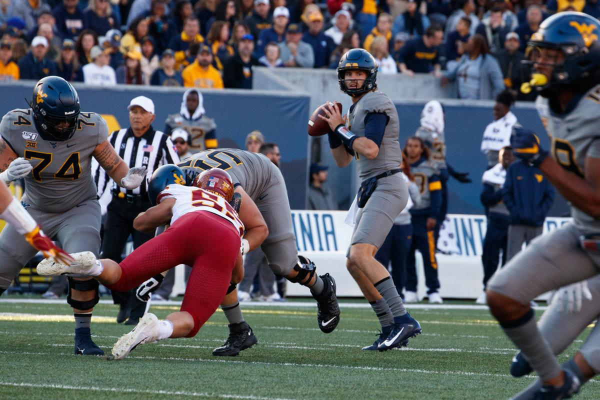 October 12, 2019: West Virginia's Jack Allison surveys the field. Allison replaced the injured Austin Kendall at quarterback during the first quarter.