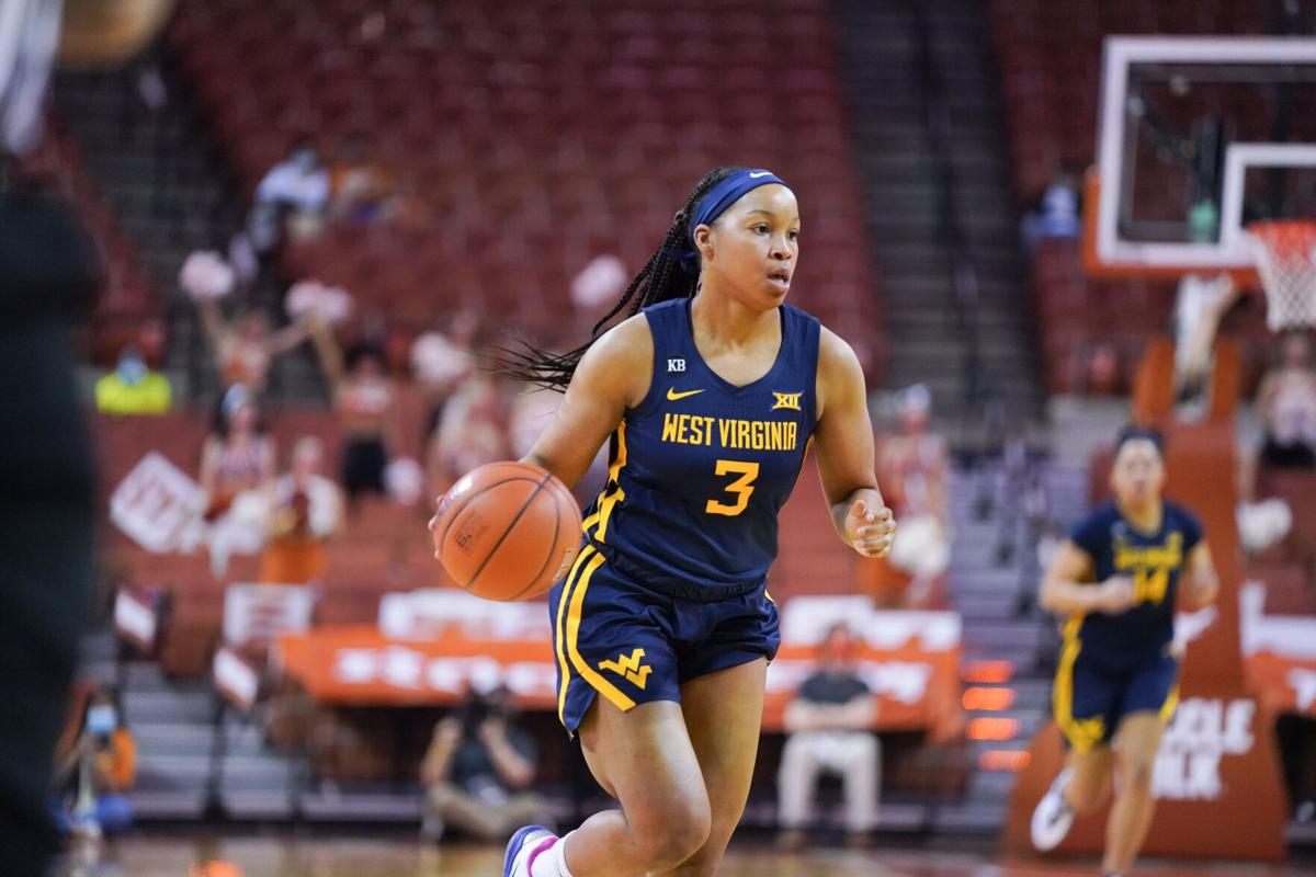 West Virginia guard Kirsten Deans (3) dribbles up the floor for the Mountaineers against the Texas Longhorns in Austin, Texas, on Feb. 6, 2021.